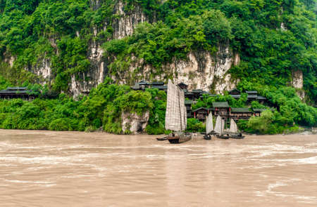 yangtze river: Traditional Chinese village and a boat on the Yangtze River in the mountains