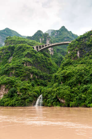 yangtze river: Travel by boat on the Yangtze River with a view of the falls