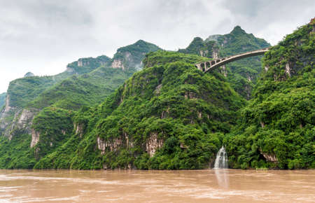 forest river: Travel by boat on the Yangtze River with a view of the falls