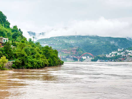 yangtze river: travel on the Yangtze River, with beautiful views of the mountains and the town Stock Photo