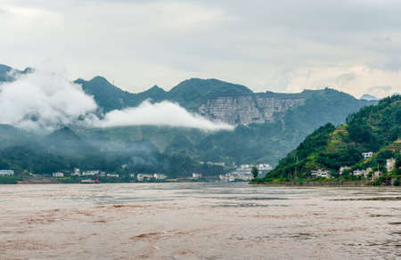 Travel on the Yangtze River with a view of the mountains and the town photo