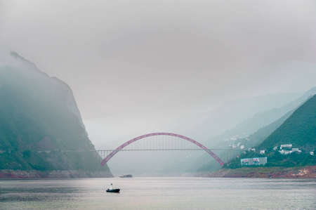 journey on the Yangtze River with a view of the mountains and the bridge photo