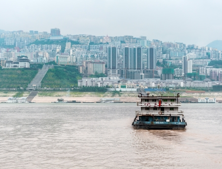 yangtze: YANGTZE - AUGUST 22: Cargo ship sails on the Yangtze River to the Chinese city, on August 22.2012, Yangtze, China Editorial
