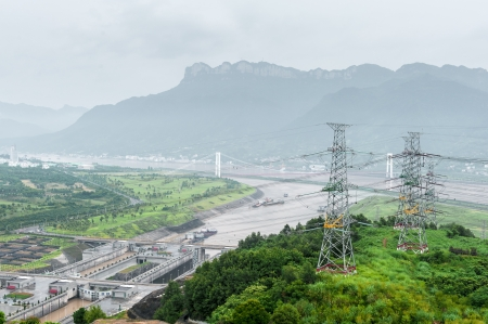 gorges: View of the Three Gorges Dam on the Yangtze River in China in misty ambiance