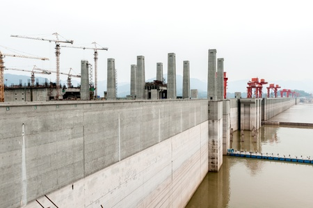 three gorges: View of the Three Gorges Dam on the Yangtze River in China in misty ambiance