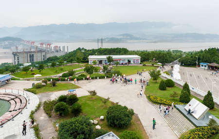 SANDOUPING-AUGUST 21: Tourists walk on the viewing platform Three Gorges Dam, on August 21,2012, Sandouping, China