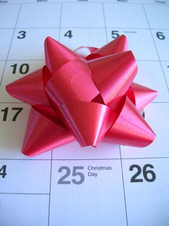 christmas day: Christmas Day on a calendar with a red bow.