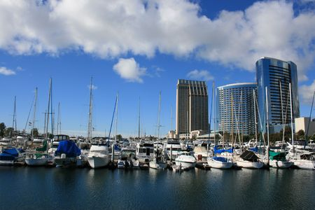 near side: A view of the San Diego harbor and East Side skyline near the Convention Center.