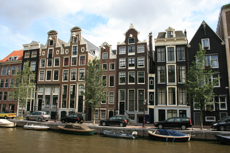 dutch canal house: Along a canal in Amsterdam.  View includes the smallest house in the city.