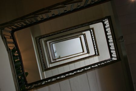 Looking up underneath a spiral staircase.