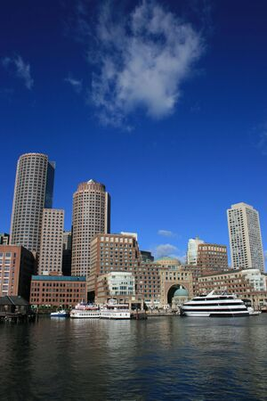 wharf: A view of Boston Harbor including Rowes Wharf.