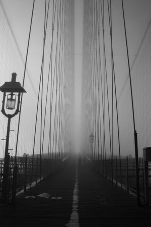 Path along the Brooklyn Bridge on a foggy morning. Stock Photo - 4515970