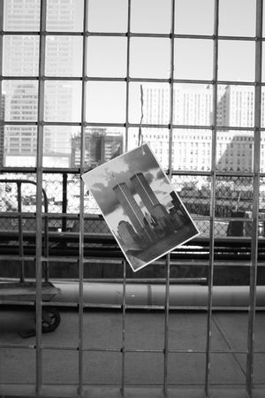 Photograph of the Twin Towers on a fence outside the Ground Zero construction site.