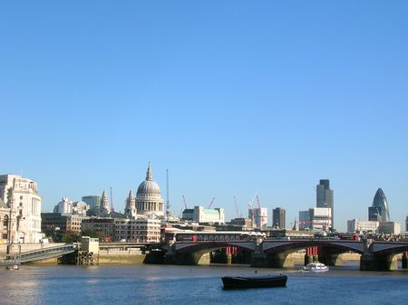 Central London view along the River Thames including the Blackfriars Bridge and Saint Pauls Cathedral.