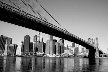 Brooklyn Bridge and Lower Manhattan skyline along the East River.