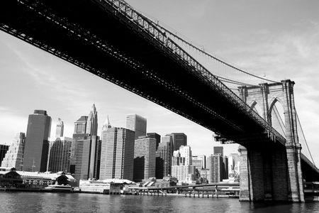 contrast: Brooklyn Bridge and Lower Manhattan skyline along the East River.