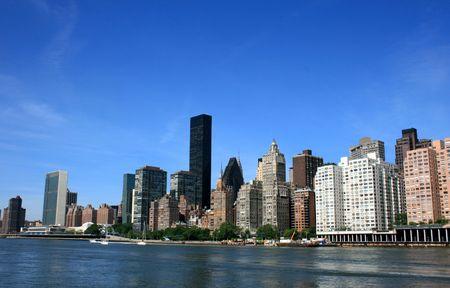 Midtown Manhattan skyline along the East River as seen from Roosevelt Island. photo