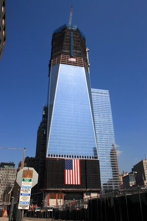 New York City, USA - September 12, 2011- A giant American flag hangs from Tower One at the World Trade Center for the anniversary of 911.
