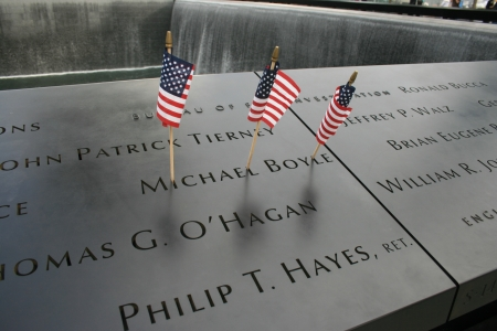 New York City, USA - September 17, 2011 - Flags left at the 911 Memorial at Ground Zero.