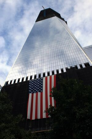 New York City, USA - September 17, 2011 - A flag hangs from World Trade Center Building One to mark the tenth anniversary of 911.