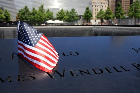 New York City, USA - May 19, 2012 - Flag left at the National 911 Memorial at Ground Zero.