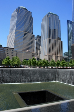 New York City, USA - May 19, 2012 - North Pool at the National 911 Memorial, World Financial Center in the background.
