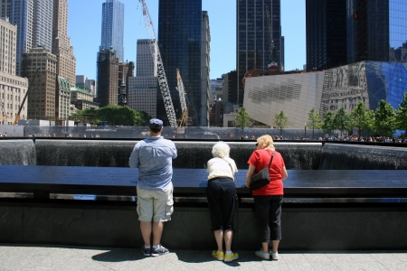 New York City, USA - May 19, 2012 - Family gathered at the National 9/11 Memorial at Ground Zero. Stock Photo - 13692280