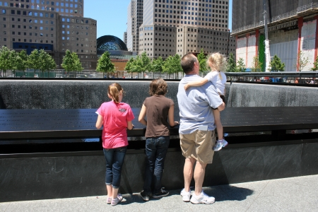 New York City, USA - May 19, 2012 - Family gathered at the National 911 Memorial at Ground Zero.