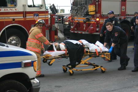 New York City, USA - January 9, 2013 - Injured person being brought to an ambulance by FDNY following a ferry crash. Editorial