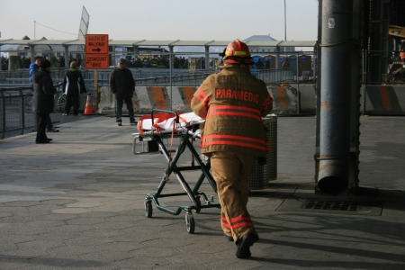 New York City, USA - January 9, 2013 - Paramedic rushing to help people injured in a ferry accident.