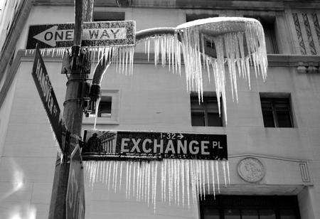 frigid: New York City, USA - Februaru 17, 2014 - Icicles haning from a street sign as frigid conditions continue in the Northeast