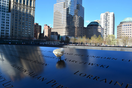 New York City, USA - April 27, 2014 - Rose left at the National 9 11 Memorial   The flower commeroates the birthday of a victim killed in the terrorist attacks
