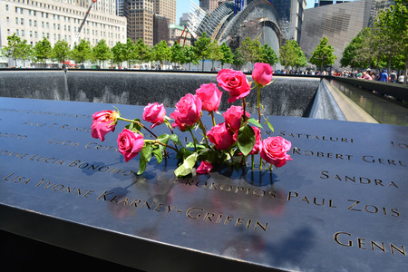 New York City, USA - June 2, 2014 - Flowers left at the National 9 11 Memorial at Ground Zero  Editorial