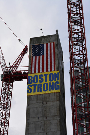 bombings: Boston Massachusetts, USA - July 5, 2014 -  Boston Strong  banner hung at a construction site to honor those affected by the marathon bombings