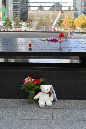 New York City, USA - September 11, 2014 - Items left at the National 911 Memorial on the anniversary of the attacks.
