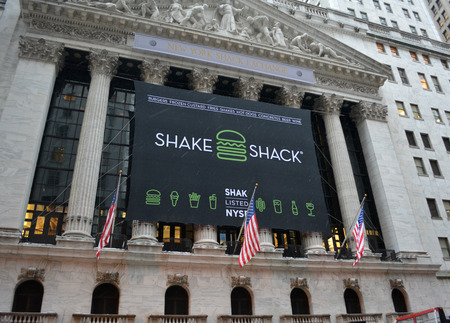 initial public offering: New York City, USA - January 30, 2014 - Celebrating the IPO for Shake Shack at the New York Stock Exchange.