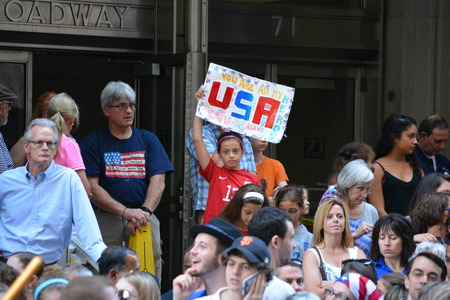 young womens: New York City USA July 10 2015 - Young fan at the victory parade for the Womens World Cup team.