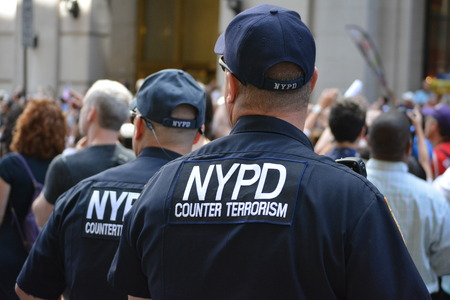 counter terrorism: New York City USA July 10 2015 - NYPD protecting the crowd at the Womens World Cup victory parade in Manhattan.