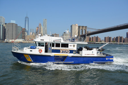 responding: New York City August 16 2015 NYPD boat responding to an emergency on the East River.