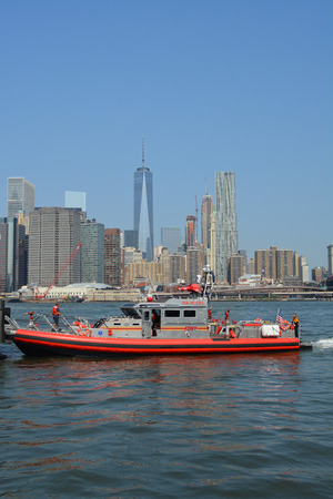 responding: New York City August 16 2015 FDNY boat responding to an emergency on the East River.