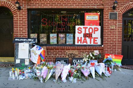 outside shooting: New York City June 13 2016 - Memorial for the shooting victims in Orlando outside the landmark Stonewall Inn.