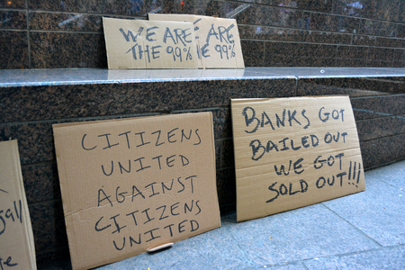 occupy movement: New York City June 17 2016 - Sings in Zuccotti Park as the anniversary of the start of the Occupy Wall Street movement is marked. Editorial