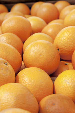 Closeup of oranges in wood box from market