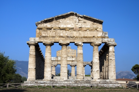 Ancient ruins of greek temple dedicated to the god Athena, Paestum, Naples, Italy.  photo