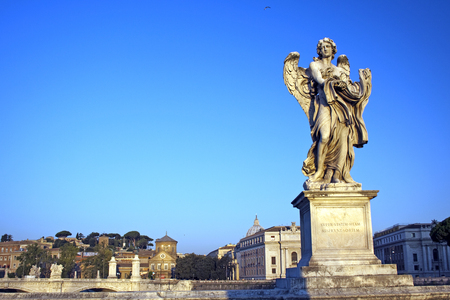 tevere: Angel with Garment and Dice near Castel Sant Angelo, Rome, Italy