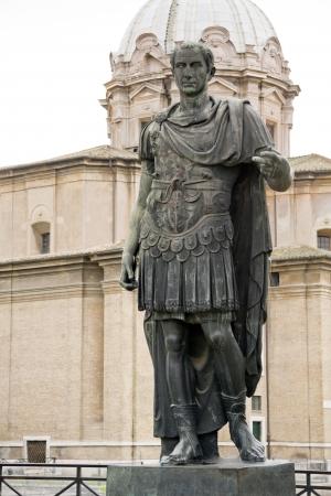 Statue of emperator Julius Caesar in Rome, Italy photo