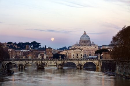 Sunrise and fullmoon view of the St. Peters cathedral in Rome, Italy  photo