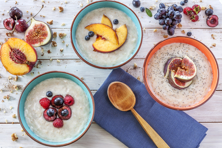 Morning breakfast with porridge, fruit and poppy seads