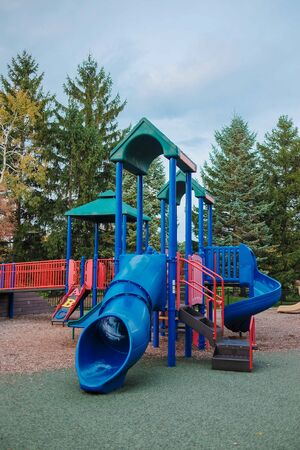 abandon: Happy Childhood kid playground fun for leisure and recreation activity with toy,stairs slides equipment leftover and climb.Nobody season ladder nature ground outdoor on yard in the park in color style