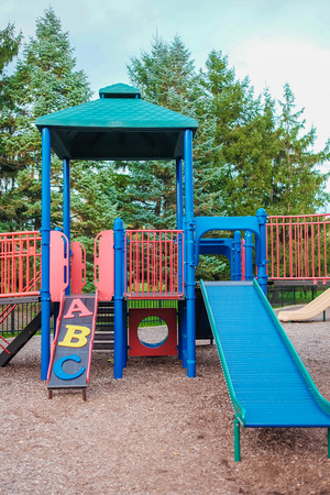 niños abandonados: Happy Childhood kid playground fun for leisure and recreation activity with toy,stairs slides equipment leftover and climb.Nobody season ladder nature ground outdoor on yard in the park in color style